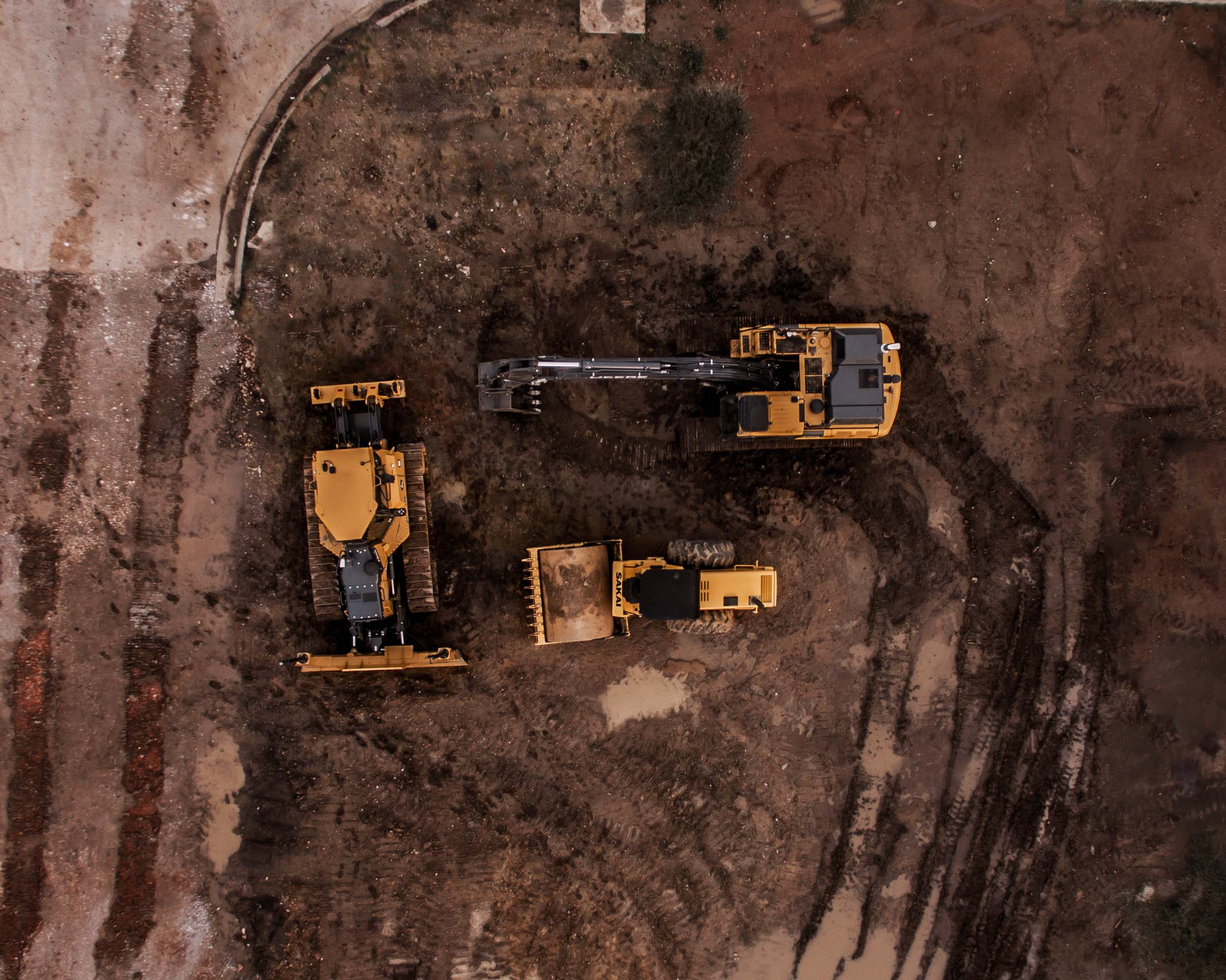 Plan view of various large extraction/mining vehicles